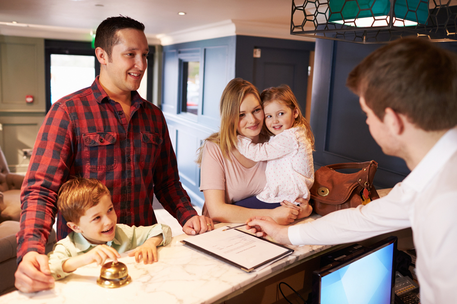 family checking in to a hotel in miami request for a deal