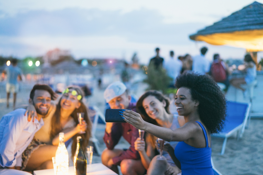 friends taking a selfie on the beach in miami
