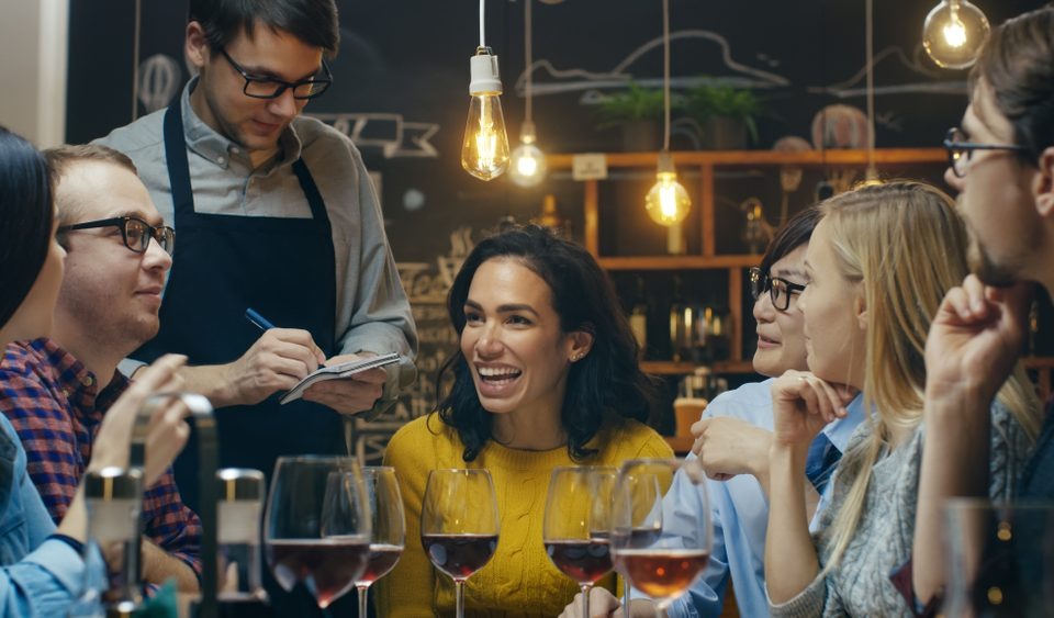 people ordering dinner over a glass of wine at a miami restaurant