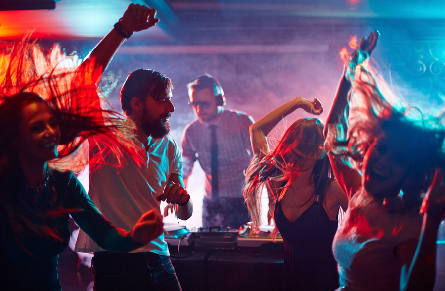a group of friends dancing at a club at New York. nightclub culture