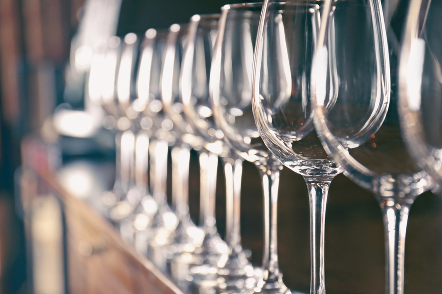 a row of glasses in a row at a bar New York nightclub culture