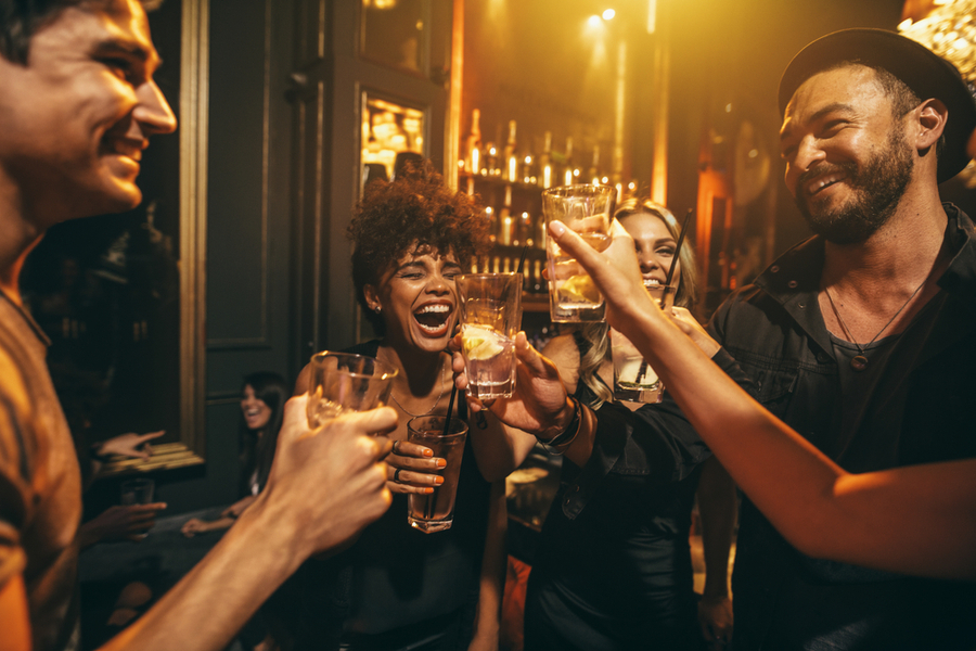 a group of people who are at a New York nightclub having drinks