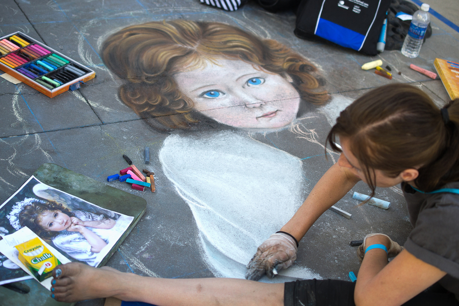 Painting Art Mural with chalk on street at the Pasadena Chalk Festival