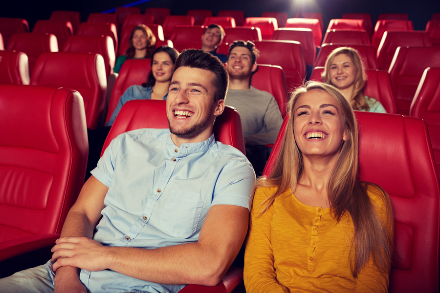 people sitting at a theatre watching a stand up show in clifornia